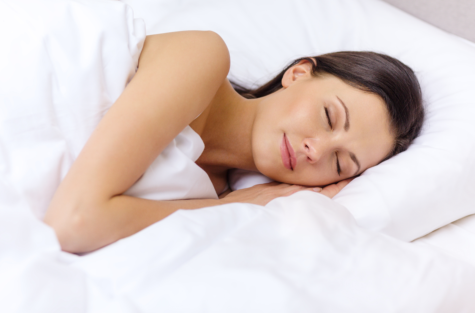 hotel, travel and happiness concept - beautiful woman sleeping i